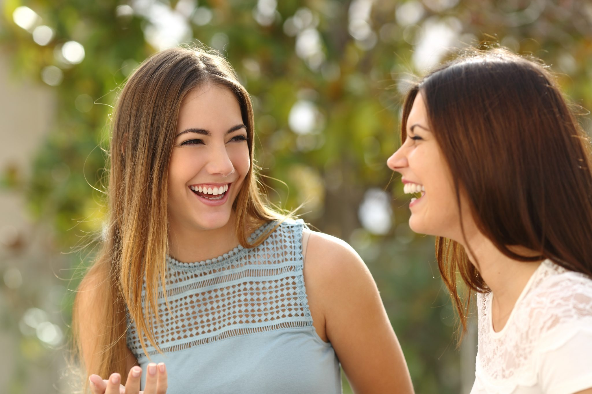 bigstock-Happy-Women-Talking-And-Laughi-87121232